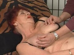 Granny redhead bangs pussy with a dildo