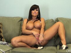 Lisa Ann bends over to show off both her ass and massive tits