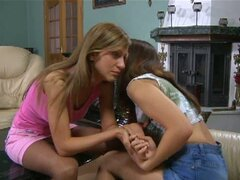 Young lesbians play with stockings and each other!
