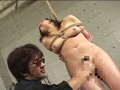 Sweet japanese babe cries in pain in bondage.