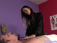 Tattooed brunette masseuse gives a massage...