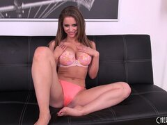 Sexy brunette babe Emily Addison exposes her luscious breasts on the couch