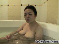 Plump asian broad soaks in the tub after pleasuring her lover