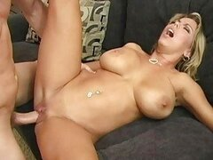 Sexy busty blonde milf doing blowjob...