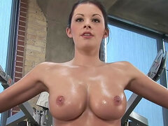 Oiled up naked body during workout