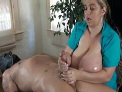 huge boobs girl gives a handjob