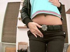 Sunny moans loudly while pounding her holes with a dildo