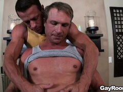 Young jock gets oiled up and massaged by a muscular older man