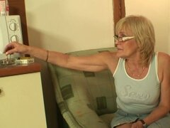 Horny granny fucked on table by muscled stud