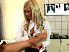 Blonde lesbian doctor gives her patient a hot exam and a footjob