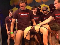 Group of guys bang a brunette bitch dressed in lingerie