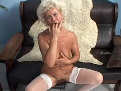 Kinky blonde granny Effie moans crazily while fingering her pussy