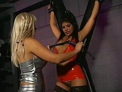 Sexy Submissive Latina Gets Whiped By Blonde Dominatrix in a BDSM Cross