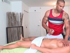 Gay afro masseur giving blowjob to his straight client