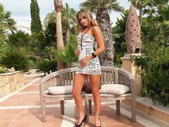 Sexy blonde was alone at the resort and got naked outdoors for pleasure