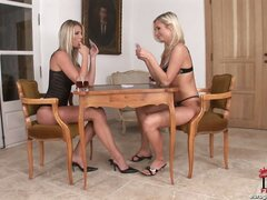 These two hot blondes are enjoying a bit of strip poker and a relaxing drink at home...but it isn't long before they're enjoying each other and a couple of huge dildos. Enjoy!
