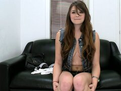 Amateur brunette bares her cute tits on the casting couch and gets fondled
