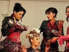 Food fight with classy clothed women