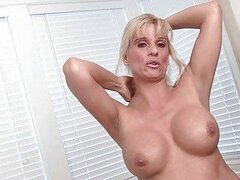 Classy blonde MILF strips and pokes her cunt