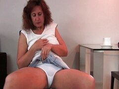 Granny fucks her hairy pussy with a dildo