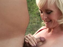 Curvy granny loves anal sex outdoors