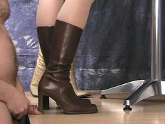 Cock crushed under sexy girls boots