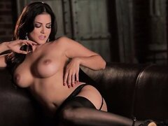 brunette with big boobs on brown sofa
