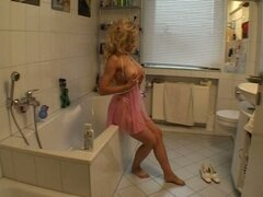 Sexy blonde milf gives her man a show in the bathroom