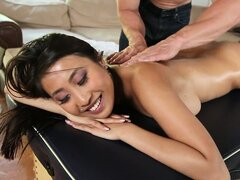 Sexy busty Asian girl gets her gorgeous body oiled for a hot massage