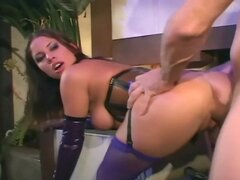 Brunette fucking in latex lingerie and a corset