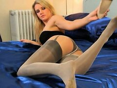 Blonde model in nylons posing for a cam