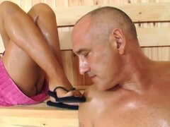 She strokes his cock with feet