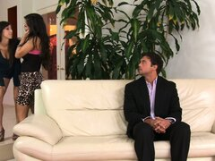 Brunette April O'Neil invites a friend over and then both suck dick