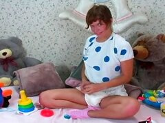 Brunette diaper girl takes it off and rubs her pussy before putting on new one