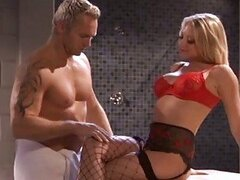 Sexy muscled hunk fucks hot blonde in fishnet stockings