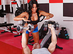 Lezley Zen's working as a personal trainer and she's got a new client, but she doesn't know which of the two guys it is in the gym. Johnny Sins tricks the other guy into leaving the gym so he's alone for some one on one time with Lezley. First Lezley show