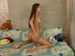 Shy teen gets her clit wet with excitement