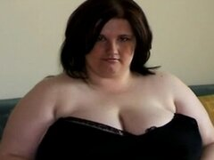 Fat young woman with big tits stripping and playing