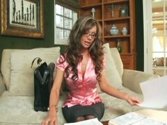 Busty milf Crissy Moran teases in stockings a garter and heels