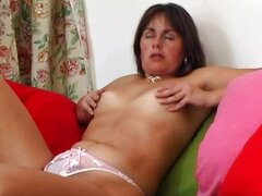 Mature mom rubs her hairy pussy