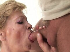 Horny grandma sucks a small stick...