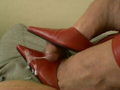 Footjob in red high heels