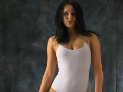Body in spandex leotard bending lustily