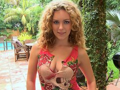 A cute curly haired doll gets chatting with a guy with a camera about sex