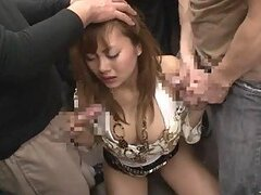 Pretty Japanese chick sucks two cocks in a public bus