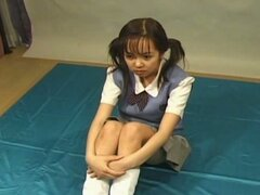 Japanese schoolgirl enjoys bukkake with pleasure