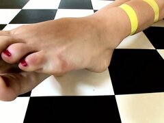 Two kinky babes with a thing for feet get frisky with each other
