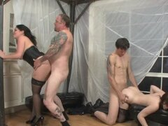 Two sexy brunettes have foursome sex with two bisexual dudes