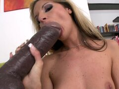 Sexy blonde Bambi takes a massive dildo in her mouth and sucks it down