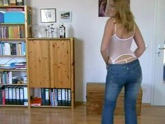 Horny mature blonde stripping...